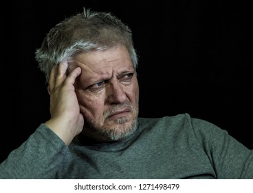 a portrait of a thoughtful, older man