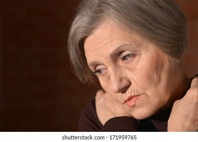 Portrait of thoughtful sad elderly woman