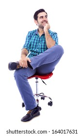 Portrait of a thoughtful smiling man sitting on the chair, isolated on white background
