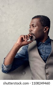 portrait of thoughtful stylish african american man in waistcoat