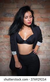 Portrait of thoughtful woman wearing black bra and jacket