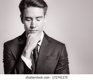 Portrait of thoughtful young business man