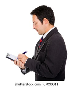 Portrait of thoughtful young business man taking notes against white background