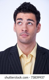 Portrait of a thoughtful young businessman with black suit and yellow shirt