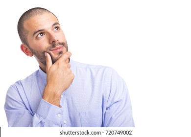 Portrait of a thoughtful young businessman, isolated on a white background