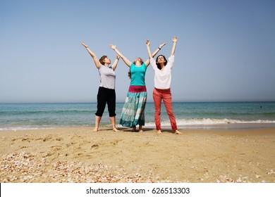 Portrait of three 40 years old women on seaside