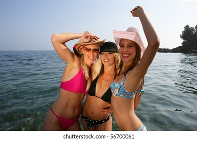 Portrait of three beautiful women bathing in the sea
