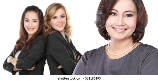 portrait of  three businesswoman smiling to camera