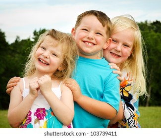 Portrait of three children playing at park