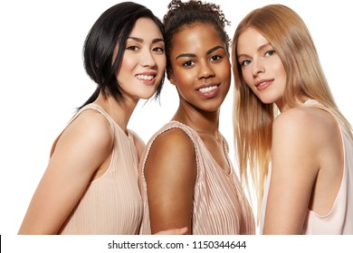 Portrait of three different nation women asian african-american and caucasian are brought together with diverse type on skin. Isolated on white background