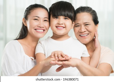 Portrait of three females: grandmother, mother and daughter