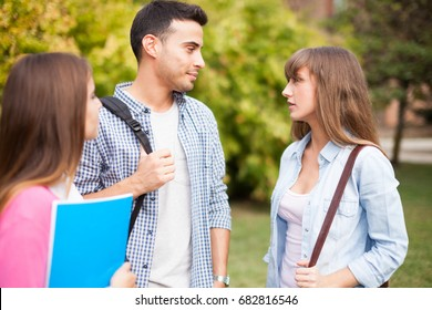 Portrait of three friends talking in a park