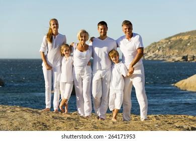 Portrait of a three generation family on a rocky coast.