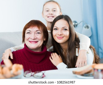 Portrait of three generations of happy women of one family at home