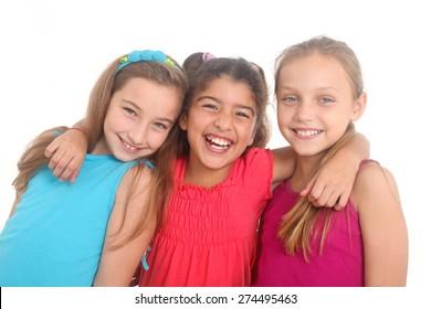 portrait of three happy girls on a white background