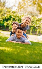 Portrait of three little children as a tower