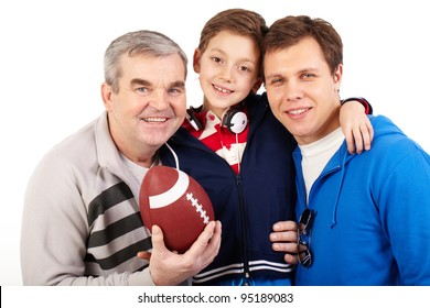 Portrait of three male family members of different age with a soccer ball