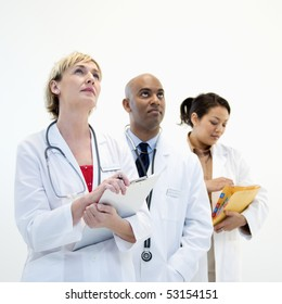 Portrait of three male and female doctors in lab coats.