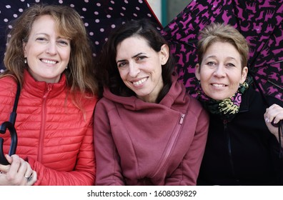 Portrait of three mature beautiful women outside
