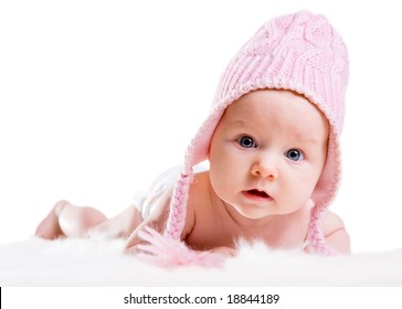 Portrait of three months old baby girl wearing pink winter hat