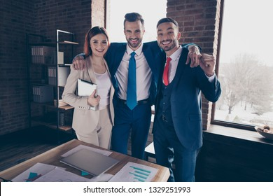 Portrait of three nice elegant stylish beautiful handsome cheerful cheery friendly business sharks hr managers great result recruiting in loft industrial interior work place station