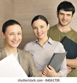 Portrait of three office workers. Office background.