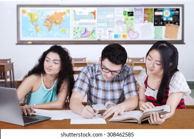 Portrait of three overseas students studying together in the classroom