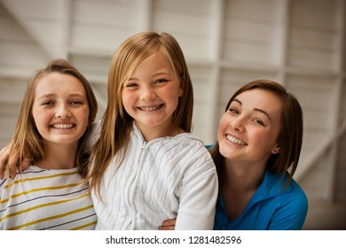Portrait of three smiling sisters.