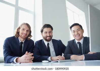 Portrait of three successful entrepreneurs looking at camera