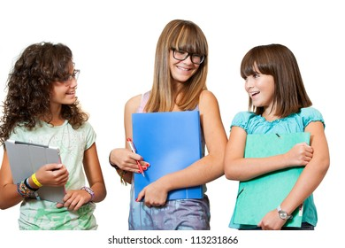 Portrait of three teenage students with notebooks and files.Isolated