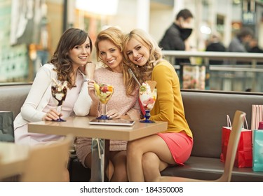 Portrait of the three young cheerful girlfriends