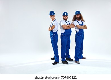 Portrait of three young craftsmen ready to work