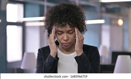 Portrait of Tired African Businesswoman having Headache