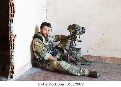 Portrait of Tired American Soldier Resting from Military Operation; Looking at Camera; Indoor Ruins Location