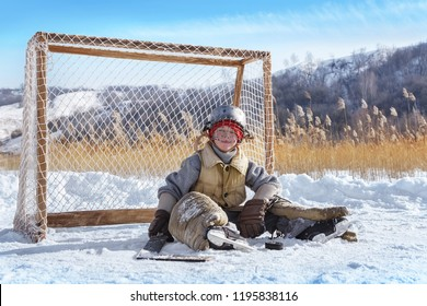 Portrait of a tired goalkeeper at the gate on a frozen lake