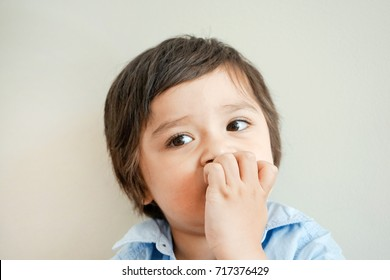 Portrait of toddler boy biting his finger nails while looking at camera in retro tone, Childhood and family concept, Emotional Child portrait,