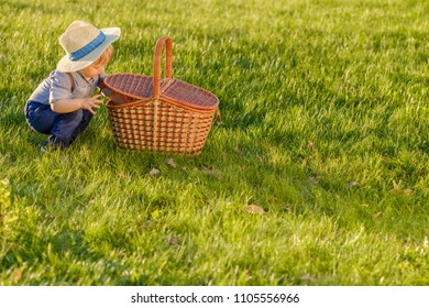 Rural scene with one year old baby boy wearing straw 7f0d5b24ebd