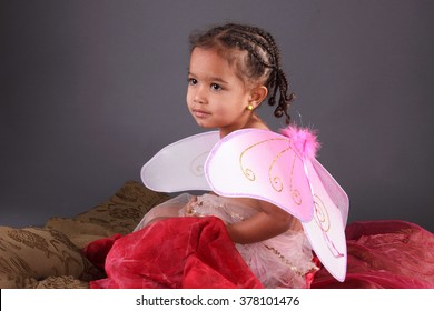 Portrait of a toddler in fairy wings