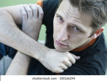 Portrait in top view of young sad man
