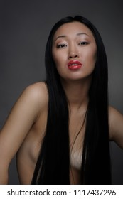 Portrait of topless censored asian woman in studio