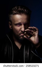 Portrait of a tough guy smoking cigar