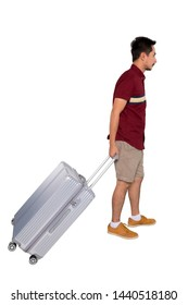 portrait of a tourist walking with suitcase isolated on white background