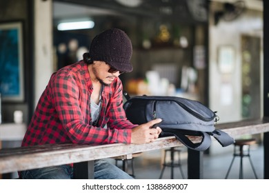 Portrait, Traveller using smartphone in cafe