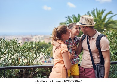 Portrait of travelling family of three people.