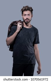 Portrait of a trendy bearded man on a gray background