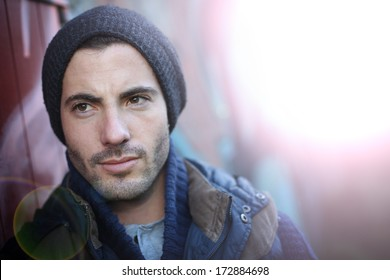Portrait of trendy guy in abandoned place