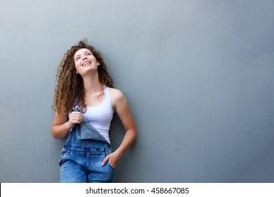 Portrait of trendy happy teen girl standing with hand in pocket