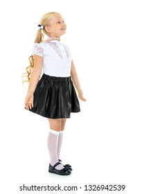 Portrait of a trendy little girl on a white background. The concept of photo for the cover of the magazine, stylish children's clothing. Isolated.