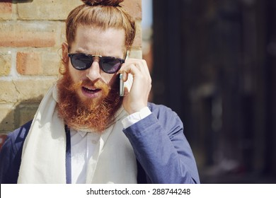 Portrait of trendy man talking on the phone