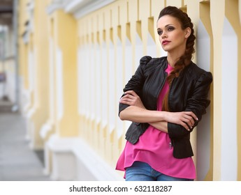 portrait of a trendy woman outdoors. Casual girl on the street